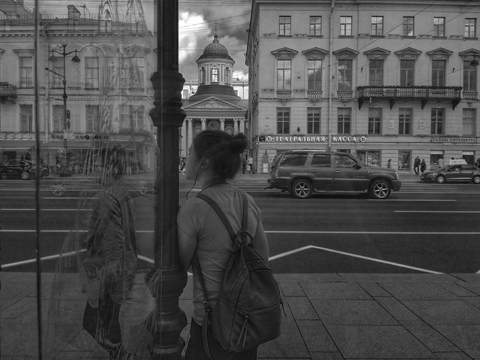 Rear view of woman on street in city