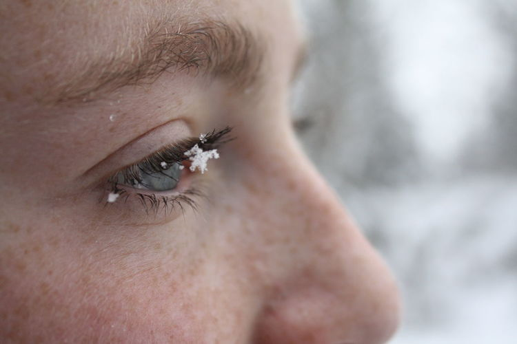 Close-up of teenage girl with snow on eyebrow