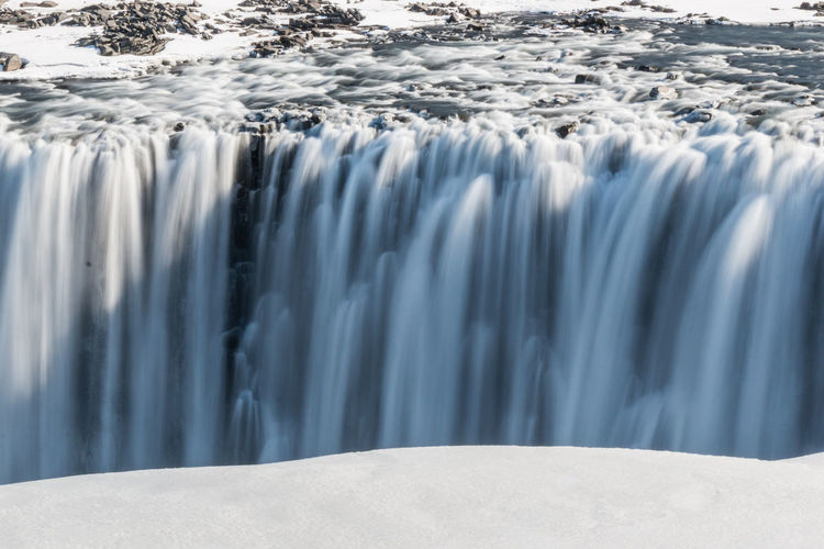 Blurred motion of waterfall during winter