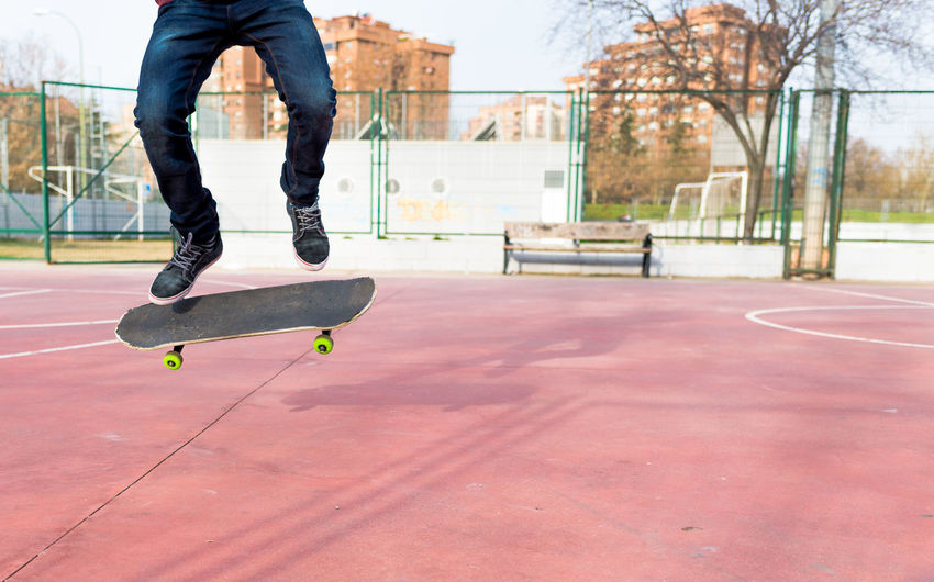 Low Section Of Person Skateboarding At Park