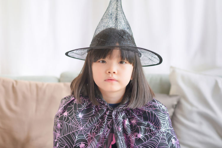 Portrait of girl wearing hat at home