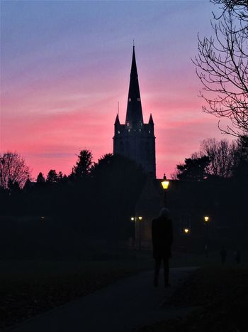Oakham Church by sunset Architecture Built Structure Church Church Spire Clock Tower One Man Only One Person Outdoors Place Of Worship Silhouette Sky Steeple Street Lamp Sunset Tree