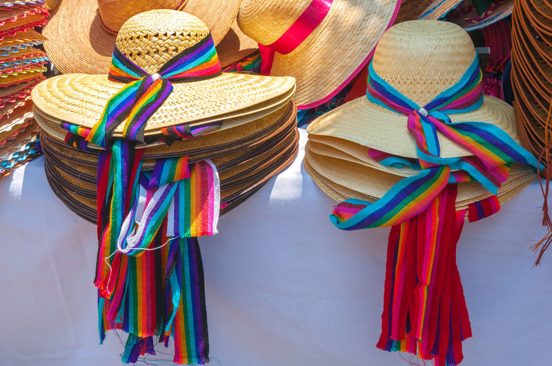 Stacked Sun Hats For Sale At Market Stall