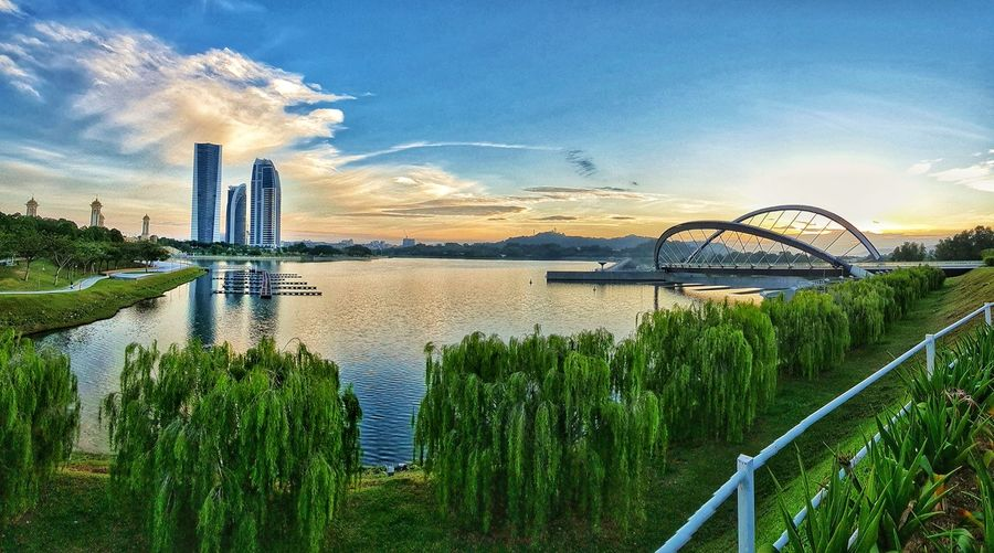 Panoramic view of bridge over river against sky