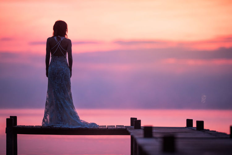 Adult Architecture Art And Craft Beauty In Nature Cloud - Sky Hairstyle Looking At View Nature One Person Outdoors Purple Rear View Scenics - Nature Sculpture Silhouette Sky Standing Statue Sunset Tranquility Women