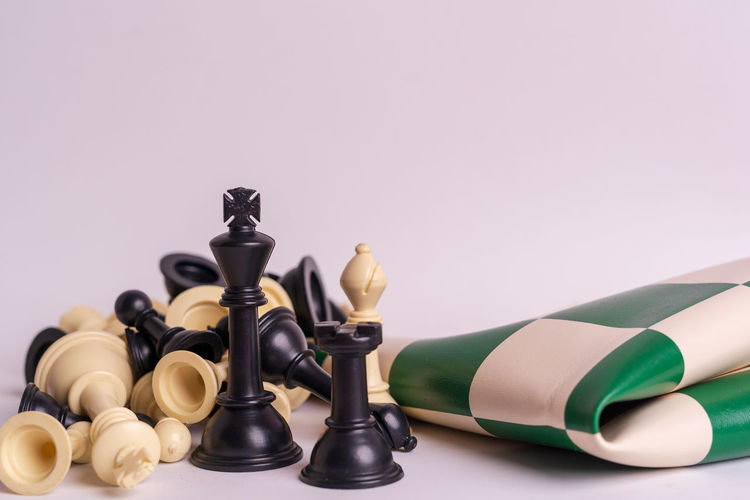 Chess set on white background. Indoors  Chess Game Competition Queen King - Royal Person King Army Strategy Leader Leadership Decisions Board Game Leisure Games Chess Piece Copy Space Studio Shot Still Life No People Relaxation Large Group Of Objects Close-up White Background Arts Culture And Entertainment Black Color Cut Out Colored Background King - Chess Piece Queen - Chess Piece Knight - Chess Piece