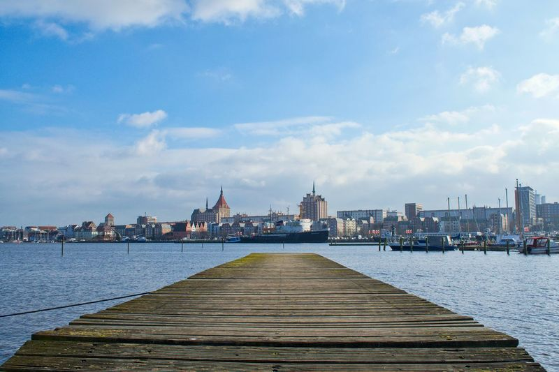 Built Structure Architecture Building Exterior Sky Water Cloud - Sky City Nature Building River Day Travel Destinations No People Religion Place Of Worship Waterfront Travel Cityscape Outdoors Hansestadt Hanseatic Pier