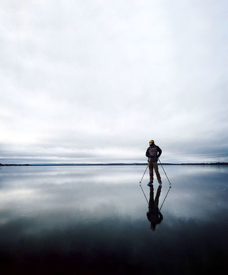 Ice Water Cloud - Sky Sky Real People Sea Beauty In Nature Reflection One Person Full Length Scenics - Nature Tranquility Tranquil Scene Nature Standing Lifestyles Horizon Day Looking At View Outdoors