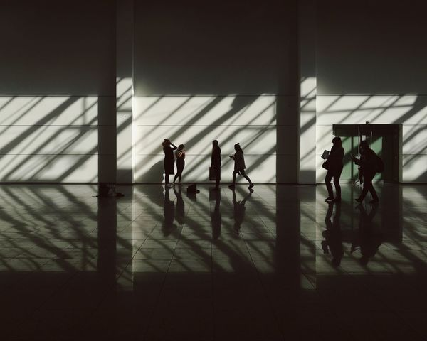 Photokina People And Places People Walking Wall Streetphotography Lowlight Köln Koelnmesse Lights And Shadows Shadows Shadowplay