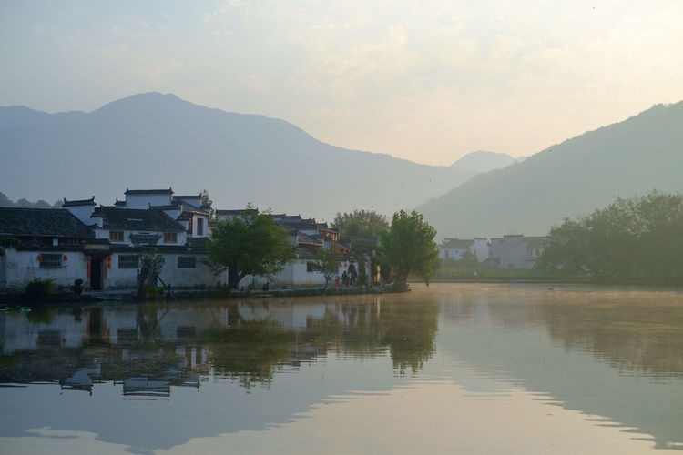 Hong cun Ancient Architecture China Photos Travel Architecture Beauty In Nature Building Building Exterior Built Structure China House Lake Mountain Mountain Range Nature No People Outdoors Reflection Residential District Scenics - Nature Sky TOWNSCAPE Tranquility Water Waterfront EyeEmNewHere