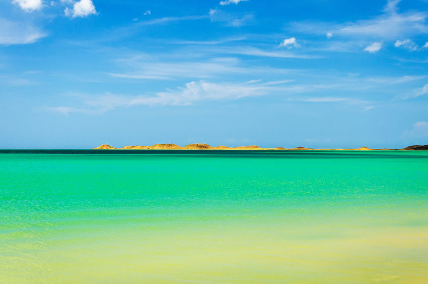 Beautiful green and turquoise water of the Caribbean Sea in La Guajira, Colombia Adventure Background Barren Beach Colombia Desert Desolate Drought Dry Dune Dunes Heat Hill Hot Laguajira Landscape Nature Outdoors Sand Scenic Sulight Summer Tourism Travel Wave