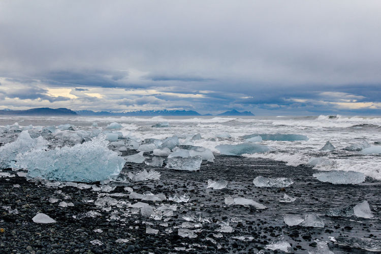 Scenic View Of Frozen Sea Against Cloudy Sky