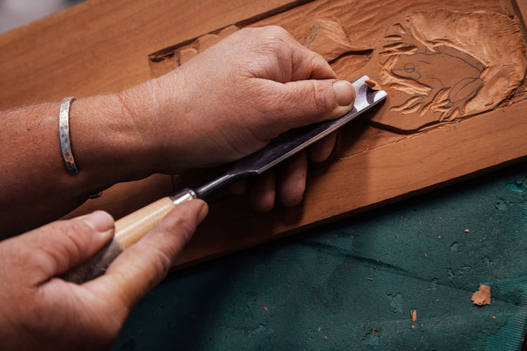 Close-up of carpenter preparing furniture