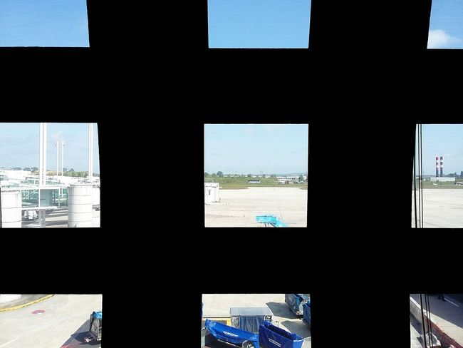 Looking Out Of The Window at Paris Cdg Airport. · France Light And Shadow Brightness Frame