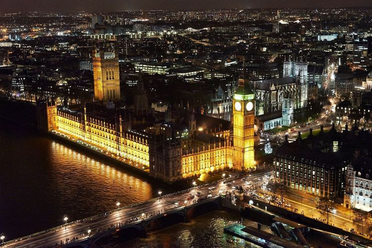 High angle view of illuminated big ben and houses of parliament
