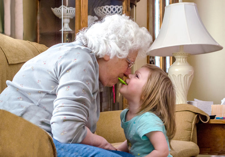 Grandmother and granddaughter playing at home