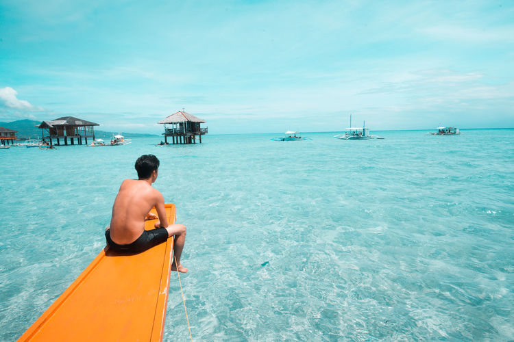 Chilling and refreshing Turquoise Colored Horizon Over Water Outdoors Land Lifestyles Leisure Activity Beach Mode Of Transportation Nature Real People Beauty In Nature Transportation Trip Vacations One Person Holiday Rear View Sky Nautical Vessel Sea Water Philippines EyeEm Selects Refreshment Sunburn