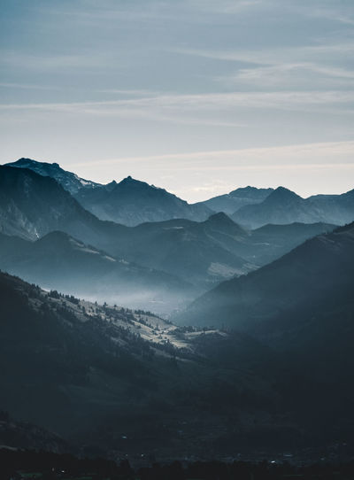 Blue Hour Hiking Mountain View Traveling Adventure Beauty In Nature Blue Sky Cold Temperature Day Evening Foggy Landscape Mountain Mountains And Valleys Nature No People Outdoors Range Sky Swiss Alps Swiss Mountains Travel Destinations Vapor Trail