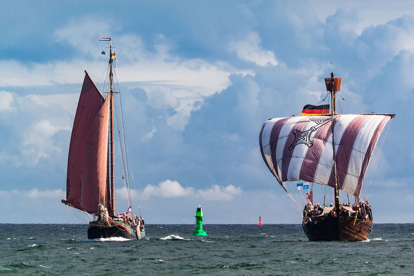Sailing ships in Warnemuende, Germany. Baltic Sea Hanse Sail HanseSail Holiday Maritime Sailing Ship Tall Ship Buoy Cloud - Sky Coast Cog Day Journey Nature Nautical Vessel Outdoors Sea Shore Sky Tourism Transportation Travel Destinations Vacation Water Windjammer