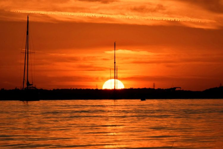 Last nights sunset at WrabnessbeachSunset SunHorizon Over Water Nikonphotography Sea Nature Capture The Moment Camera Nikon Amazing Calm Remote Water Scenics Waterfront Silhouette Sky Cloud Tranquil Scene Orange Color Tranquility Cloud - Sky Dramatic Sky Sun