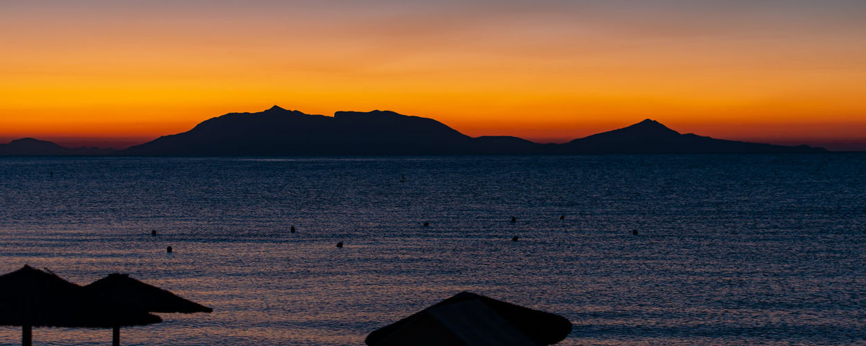 Sunrise at 6 o'clock in the morning from the beach on the mediterranean in front of kos greece