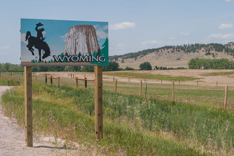 Entering Wyoming! America Americana Border Border Crossing Border Post Grassland Information Sign Landscape Non-urban Scene Outdoors Road Trip Roadside Roadside America Roadsidephotography Roadtrip Rural Scene Scenics State Border Tourism United States USA Wyoming