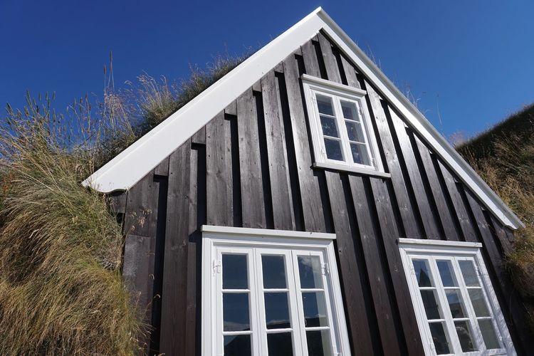 House against clear blue sky