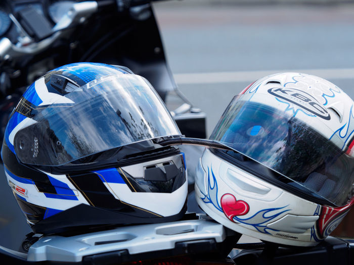 motorcycle helmets Chrome Close-up Crash Helmet Day Focus On Foreground Headwear Helmet Land Vehicle Mode Of Transportation Motor Vehicle Motorcycle No People Protection Reflection Security Shiny Silver Colored Sports Helmet Still Life Transportation