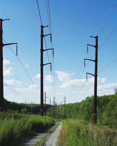Electricity Pylon On Countryside Landscape