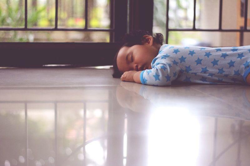 Funny baby sleeping on the floor