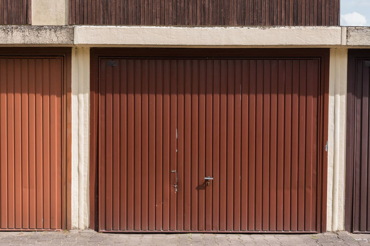 Generic brown corrugated iron garage door - old, metal Corrugated Iron Metal Generic Architecture Built Structure Iron Closed Building Exterior Security Corrugated No People Door Safety Entrance Garage Protection Storage
