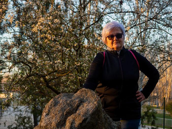 Portrait of senior woman standing in park