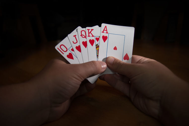 Cards Gambling Holding Person Personal Perspective Poker Royal Flush Studio Shot