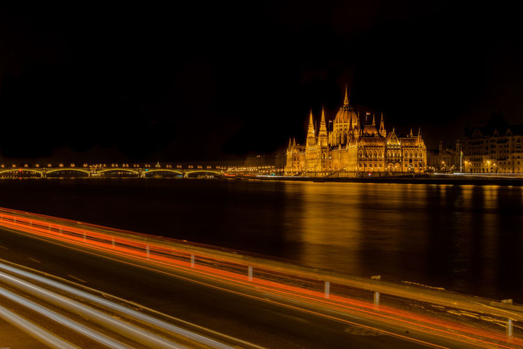 Hungarian Parliament Building, Budapest Budapest Parliament Building Reflection Stunning Stunning Collection Your Ticket To Europe Architecture Building Exterior Built Structure City Europe Illuminated Light Trail Long Exposure Longexposure Motion Night No People Outdoors Politics And Government Sky Speed Transportation Travel Destinations Water