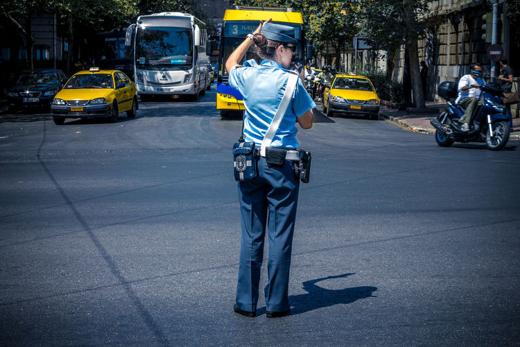 Policewoman in the streets of Athens. Athen Athens City Athens, Greece Mobility In Mega Cities Taxi Athena Athens Bus Car City Day Police Policewoman Road Street Transportation