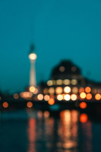 Berlin Blurred TV Tower Architecture Building Exterior Built Structure City Clear Sky Focus On Foreground Illuminated Night No People Outdoors Reflection Sky Tourism Travel Travel Destinations Water Waterfront