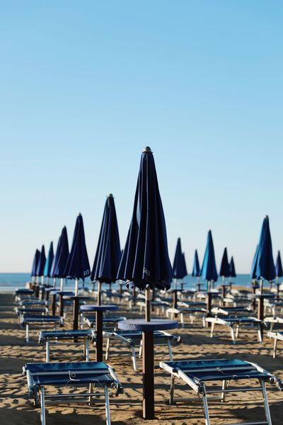 Blue umbrellas in the morning light. 💙 Darkblue Closed Umbrellas Umbrellas In The Sky Italy Space For Your Text Space For Text Sunbeds Italy🇮🇹 Summertime Blue Umbrella Umbrella Beach Umbrellas Shadows & Lights Morning Light Morning Grado Grado, Italy Sky Clear Sky Water Chair Copy Space Sea Blue No People In A Row Umbrella Day Beach Beach Umbrella