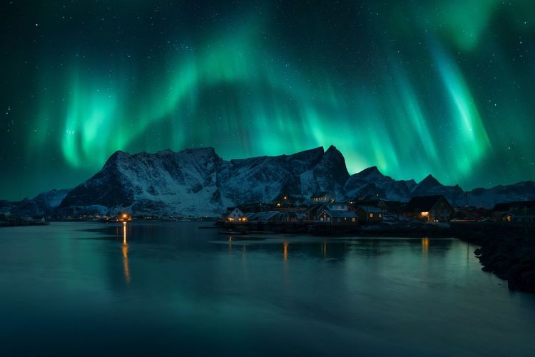 Aurora dancing over Reine (Lofoten, Norway). Aurora Borealis Aurora Village Night Nightphotography Polarlicht Norway Fisherman Stars Astronomy City Mountain Snow Star - Space Cold Temperature Space Winter Blue Illuminated Aurora Polaris Rocky Mountains Panoramic Dramatic Landscape