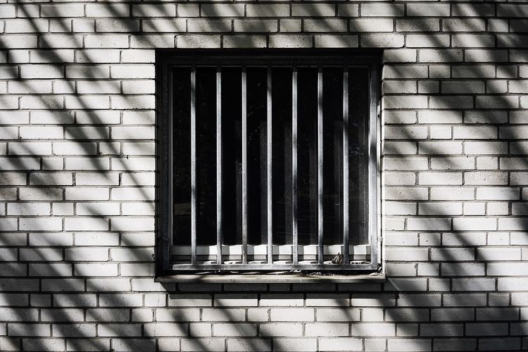 Bars Window Wall Architecture Built Structure Building Exterior Wall - Building Feature No People Brick Wall Day Brick Pattern Building Security Sunlight Protection Outdoors Closed Shadow Safety Old