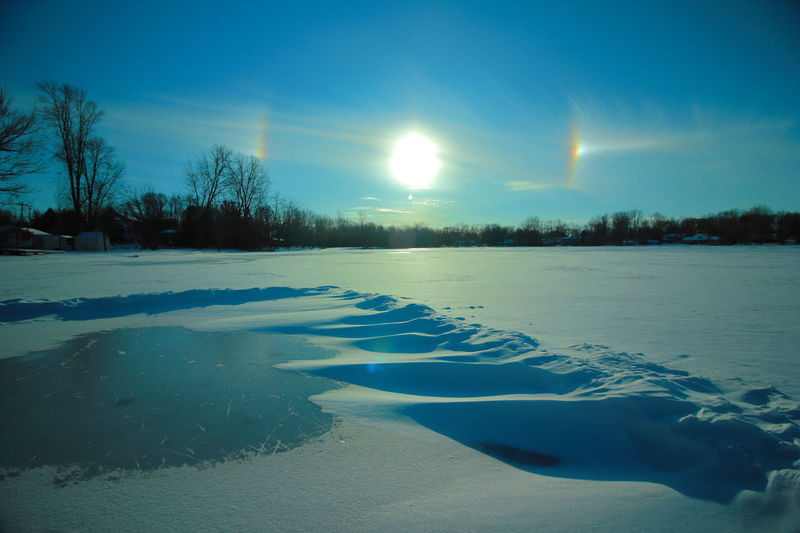Sun dogs in the sky. Halo Solar Sun Dogs In The Sky Beauty In Nature Cold Temperature Frozen Landscape Nature No People Outdoors Scenics Sky Snow Sun Dogs Tranquil Scene Tranquility Tree Winter AI Now Shades Of Winter
