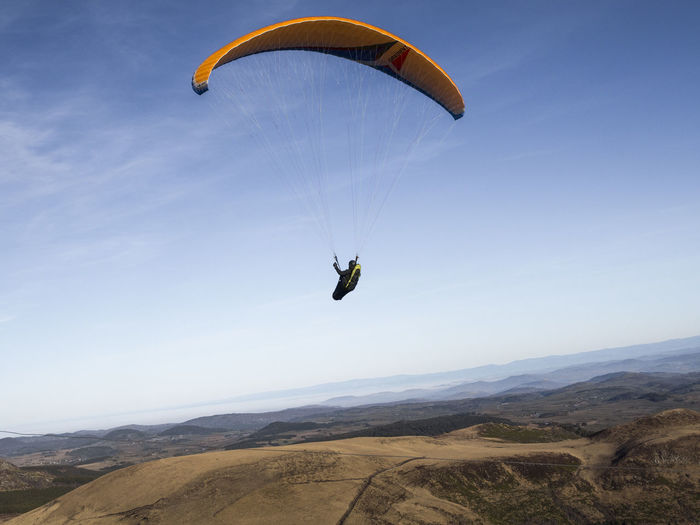 Adult Adults Only Adventure Beauty In Nature Day Exhilaration Extreme Sports Flying Freedom Leisure Activity Mid-air Mountain Nature Outdoors Parachute Paragliding People Real People Sky