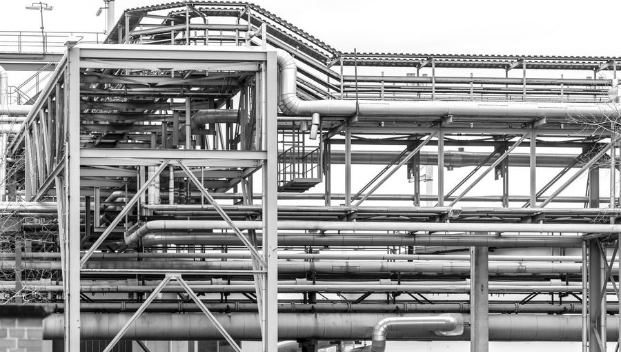 Black And White Urban Factory Business Finance And Industry Environmental Issues Industry Metal Architecture Built Structure Pipe - Tube No People Low Angle View Day Connection Pipeline Staircase Building Exterior Outdoors Railing Industrial Building  Complexity Fuel And Power Generation Technology Industrial Equipment Silver Colored Steel Alloy
