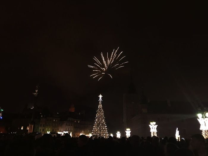New Years Eve 2018 New Years Eve Night Celebration Illuminated Large Group Of People Firework - Man Made Object Firework Display Low Angle View Christmas Tree Firework Crowd