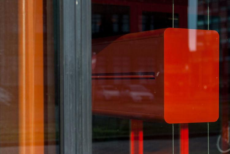 Red Box Seen Through Glass Window