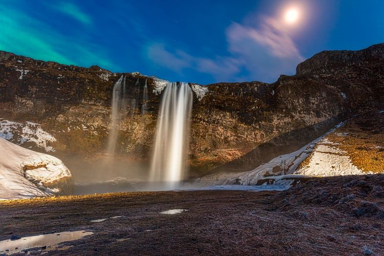 The full spectrum Iceland Northern Lights Moon Sky Night Seljalandsfoss EyeEm Selects Water Waterfall Spraying Mountain Space Astronomy Motion Power In Nature Long Exposure Sky Flowing Water Fountain Stream Natural Landmark Rock Formation Falling Water The Traveler - 2018 EyeEm Awards