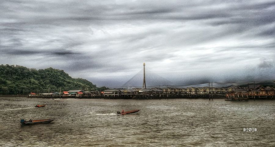 Bruneiwaterfront Cloud - Sky Bridge Bruneiriver River Watervillage HuaweiP9 Huaweiphotography HuaweiP9Photography EyeEm Outdoors Dramatic Sky Beauty In Nature Architecture Stilt Houses Watertaxis Kampong Ayer
