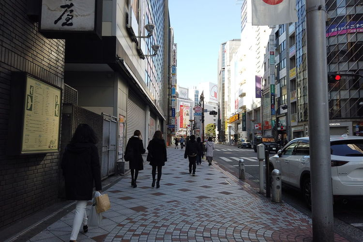 Urban Winter Street City Shibuya Tokyo Japan Architecture Building Exterior Built Structure Group Of People Real People Walking Men Women Footpath Lifestyles City Life Adult People Building Day Direction Crowd The Way Forward Outdoors