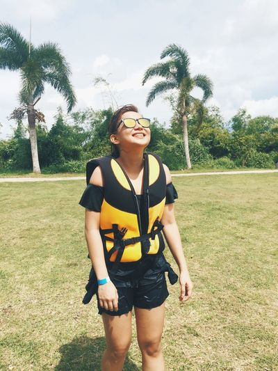 Vacation Philippines Camarines Sur Tree Young Adult Grass Sunglasses Leisure Activity Young Women Real People Day One Person Front View Sky Casual Clothing Lifestyles Nature Outdoors Standing Palm Tree Sports Clothing Adult People Candid