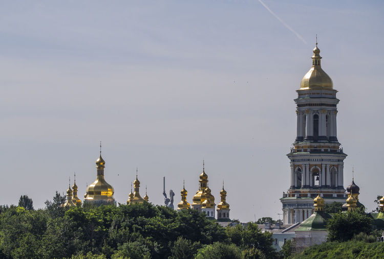 Kiev Pechersk Lavra or Kyiv Pechersk Lavra (Kyievo-Pechers'ka lavra) Kiev Pechersk Lavra Kyievo-Pechers'ka Lavra Architecture Building Exterior Built Structure Day Dome Kyiv Lavra No People Outdoors Pechersk Place Of Worship Religion Sky Spirituality Travel Destinations Tree