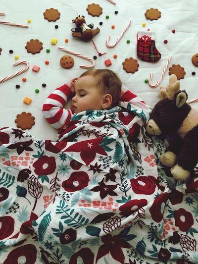 Cute baby girl sleeping on bed
